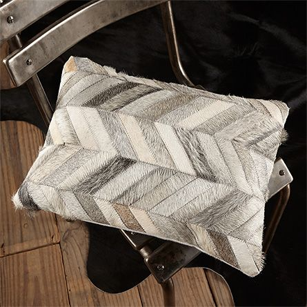 Cowhide Patch Pillow In Grey  a cheaper option to bring this into the house without the whole cow hide RH rug