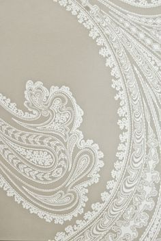 Rajapur Paisley Wallpaper Large design Paisley print wallpaper in taupe with white design.