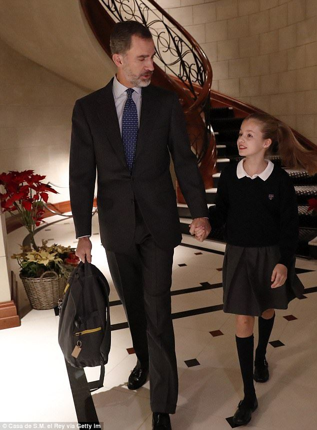 School time: Candid shots from inside the residence of the Spanish royal family show King Felipe taking his daughter Princess Leonor to school