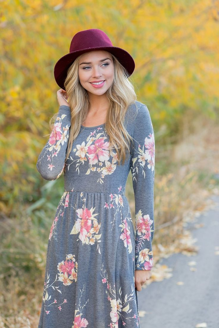This floral midi has a gorgeous floral design, a round neckline, long sleeves and a length that falls just below the knees for a stylish look that is perfect for winter.