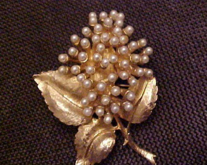 Brooch with Many Seed Pearls as trim in a Lovely Gold Plated leave setting.  FREE shipping in the United States