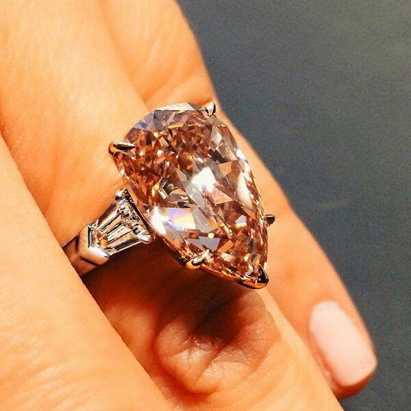Christie's Pink Representative - 9.73 carat Fancy Brown Pink Estimated at $500K-$700K. Will it break it?