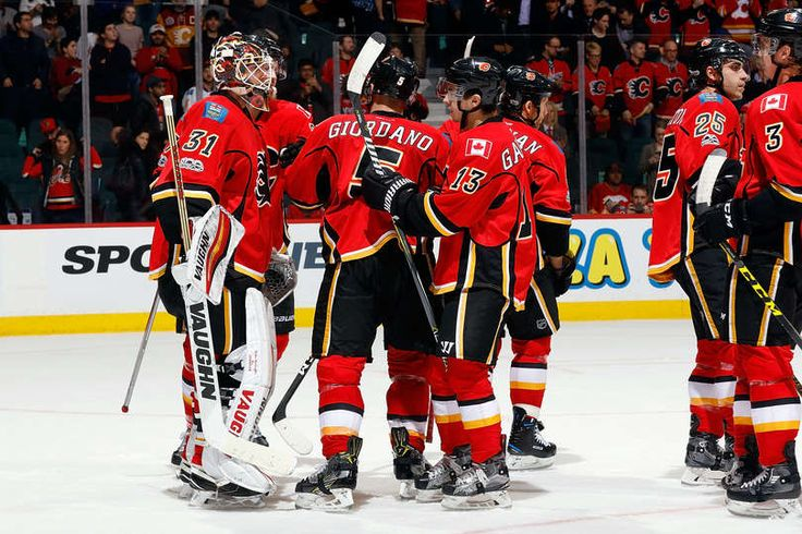 CALGARY, AB - JANUARY 17: Chad Johnson #31 and teammates of the Calgary Flames celebrate a win against the Florida Panthers during an NHL game on January 17, 2017 at the Scotiabank Saddledome in Calgary, Alberta, Canada. (Photo by Gerry Thomas/NHLI via Getty Images)