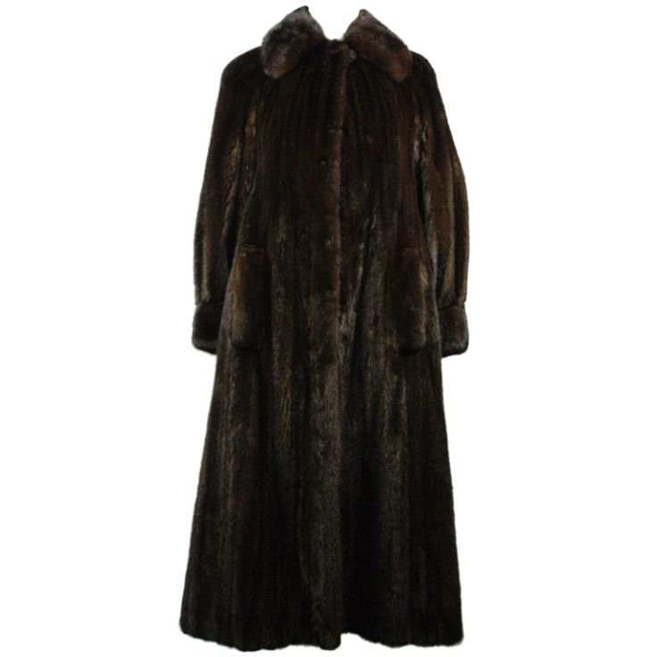 Bergdorf Goodman on The Plaza Petite Long Mink Coat | From a collection of rare vintage coats and outerwear at https://www.1stdibs.com/fashion/clothing/coats-outerwear/