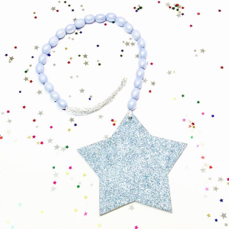 A personal favourite from my Etsy shop https://www.etsy.com/au/listing/470329036/wooden-garland-glitter-star-drop