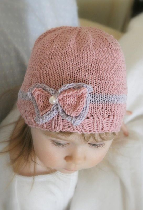 Free Knitting Pattern for Zoe Bow Beanie - Worked in round with basic stitches and cotton yarn Sizes: 6m/1y/3y/child. Designed by Muki Crafts