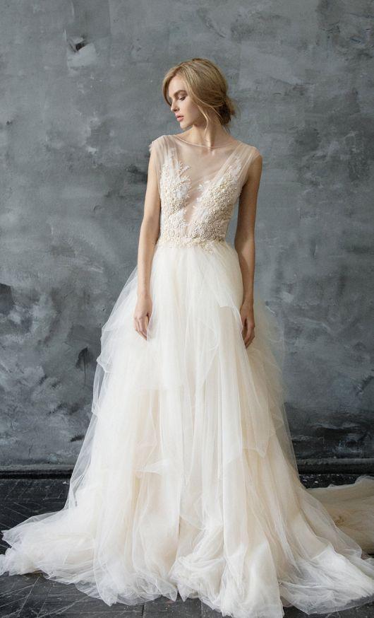 Chic sleeveless tulle wedding dress; Featured Dress: CarouselFashion