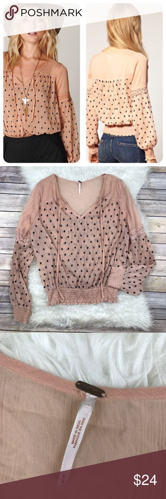 """Free People Nude Chiffon Swiss Dot Peasant Top Good condition Free People Nude Chiffon Swiss Dot Peasant Top. Size Medium. Small staining on one cuff seen in picture. Smocked hem and cuffs. Sheer. Bust 44"""", length 23"""", sleeve length 26"""". A few loose dot threads. No trades, offers welcome. Free People Tops Blouses"""