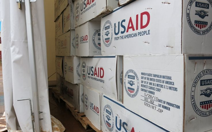 The tarps from USAID are ready to be dispatched from WFP's supply hub in Monrovia, Liberia, for the Ebola response. (6 October 2014, Photo: WFP/Martin Penner)