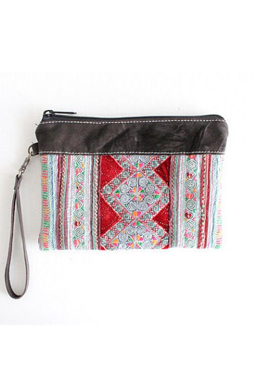 A unique hand woven vintage fabric wristlet clutch bag with genuine leather trim and strap handmade in Thailand. #offbeatcuts #offbeatboutique
