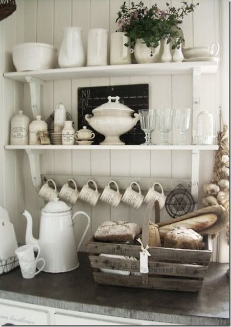 I love from the last shelf down... the white mugs on hooks, the old white coffee pot, the hanging garlic, and the wooden basket!