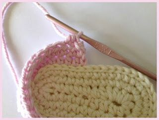 Crochet Baby Sandals Left Shoe: Starting on the same side of the sole as before, repeat rounds 1-4 as above turning after Rnd 4. (Rnd 5) Hdc across (12,14) total stitches. Chain 13 (15). (Rnd 6) Sc into bottom of 5th chain from hook (working under the chain this time). Sc 8 (10). Ss to shoe back. Tie off and weave in tail. (9,10)