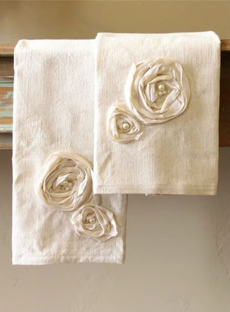 Cute hand towels---make the rosettes in burlap and with shell centers?