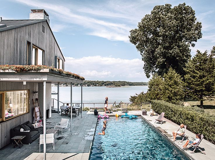 A swimming pool was on everyone's wish list. Gray Organschi installed it on the east side of the house, along with an outdoor fireplace. The outside pathways and decks are paved in ipe and bluestone.
