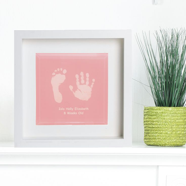 Framed glass tile displaying baby hand and foot print