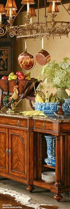 French Country... love the copper and blue with the wood!
