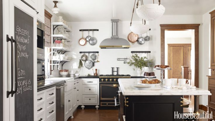 In her Ridgewood, New Jersey, kitchen, Nicole Hough designed the kitchen to fit with the period of the house while updating it with modern conveniences to make it family-friendly and highly organized. A built-in armoire has a bottom row of drawers for kids' stuff, a kitchen island offers ample seating, and pots are easily accessible since they're hung on either side of the stove.