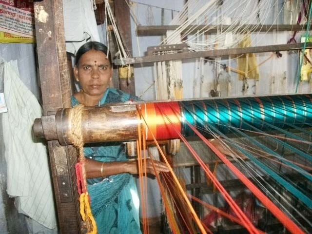 """Nirmala: a saree weaver and a MicroGraam borrower from Madurai, Tamil Nadu. She earns about Rs. 2,500 ($50) for one month of weaving.    Check out our blog post called, """"Living Below the Loom"""" to read about weavers like Nirmala: http://india.micrograam.com/?p=887    www.twitter.com/micrograam  www.facebook.com/micrograam"""