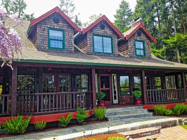 Lake front property!  Super private 2 acres and new rustic house. It reminds me a lot of the log house :) 599