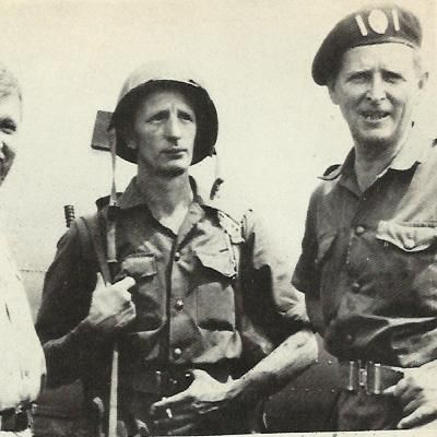 Major Michael Hoare (right), commander of 5th Congo Brigade, prepares to lead attack on Stanleyville, rebel stronghold, in 1964. Trooper holds older model FN.