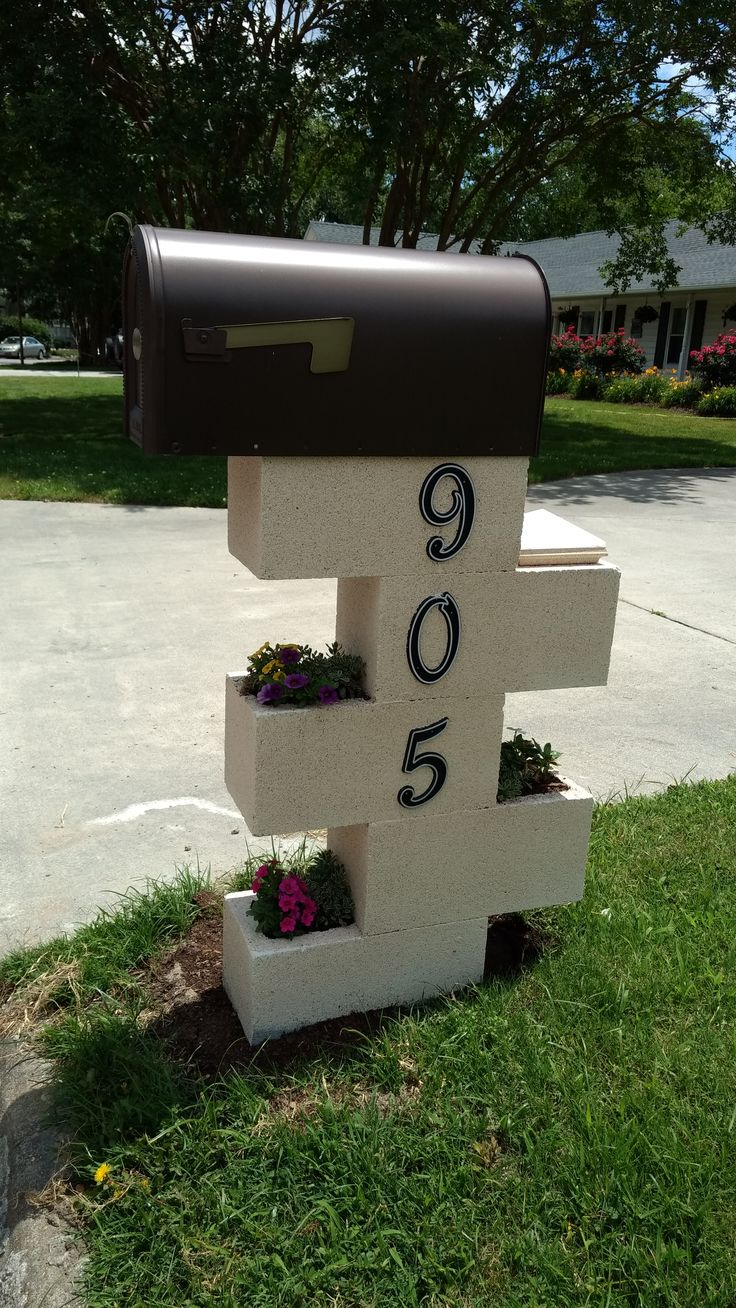 Mailbox makeover using concrete blocks.  Easy, stable, and great looking.