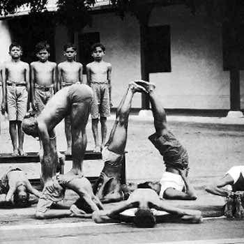 Krishnamacharya with his students at the Yogashala in Jaganmohan Palace, Mysore, 1934
