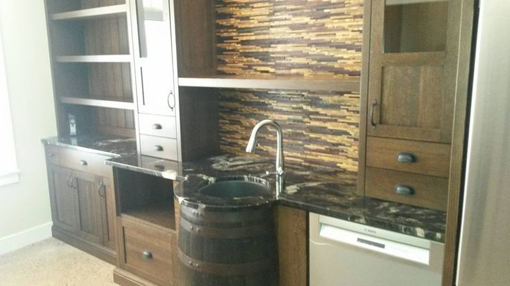 Whiskey Barrel Sink, Wine Cork Backsplash, and Titanium Granite Countertop! Perfection.