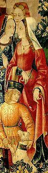 """reine roi et dauphin. Suzanne de France dans La Chasse. Sa mère Anne est la dernière personne dans """"l'espace"""" des tapisseries. A l'extrême droite, où s'achève toute lecture occidentale. Elle clôt la longue litanie des personnages qui se sont succédé depuis la première tapisserie. Dans cette tapisserie, Anne de France ne porte rien de luxueux, vêtements, bijoux etc"""