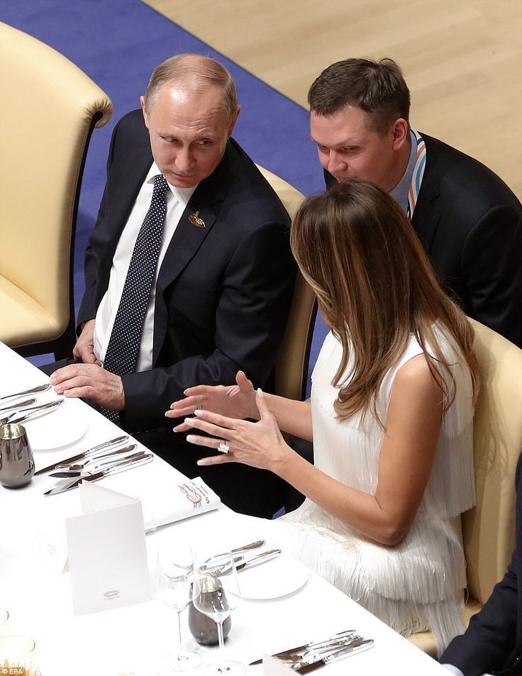 Russian President Vladimir Putin (left) is caught in conversation with American first lady Melania Trump (right) at a post-concert dinner in Hamburg, Germany