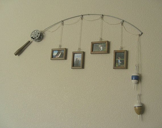 Turn an old fishing pole into wall decor for photos. Fishing Pole Picture Frame  Metal Silver  4 by DabbledDetails, $47.00