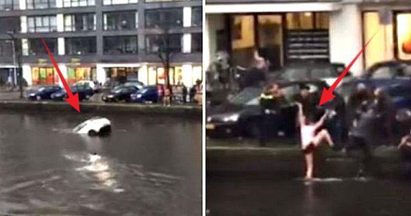Vier helden redden moeder en baby uit zinkende auto in een Amsterdams kanaal – Zie de beelden: