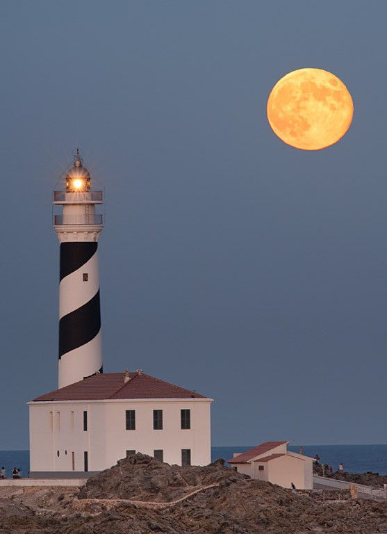 August moonrise at Favaritx lighthouse(Menorca), located on the north coast of the island. Spectacular rocky landscape. Imagine, Plan & shot.... By Antoni Cladera - Nature Photographer
