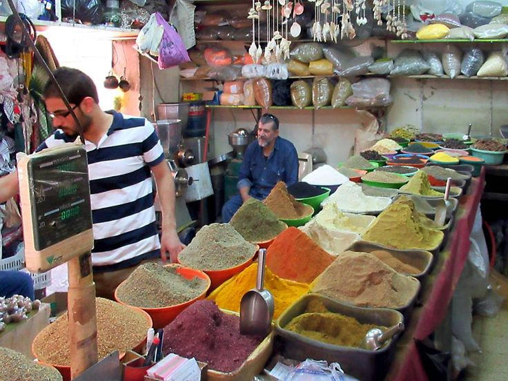 This spice shop in the market area of Aqaba, Jordan, presents a colourful scene.
