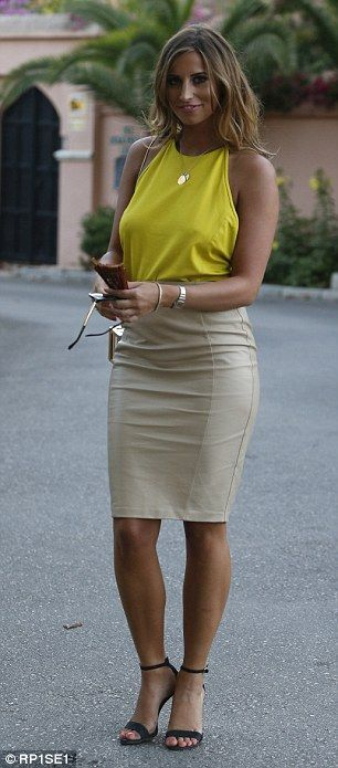 Strutting her stuff: Her co-star Ferne McCann highlighted her curves as she teamed a brigh...