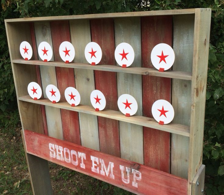 Although it is built from brand new wood, this carnival Shootin Gallery is weathered to look like it was built a century ago! Comes with 12 targets, a shooting table, and your choice of a standard or modified Nerf Gun with darts. The modified gun looks a little more realistic to match the game and the standard is brightly colored. We custom build each game, so you can choose a different color or graphic if desired. Please allow 7-10 business days for production. We also sell a weathered…