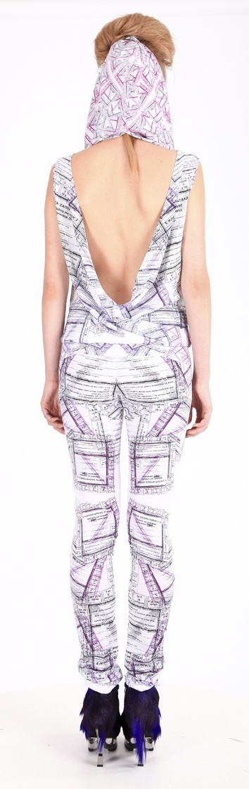 """Back view: Overall ( printed polyester, """"ticket for food"""" pattern), shoes ( leather, stain-less steel heel)"""