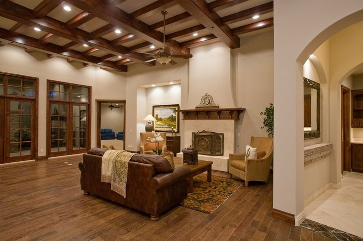 Tuscan villa style home with exposed beam ceilings and dark wood floors, discovered on www.Porch.com