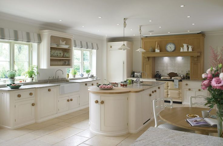 This 'Cooks kitchen' by Mark Wilkinson kitchens demonstrates a chic use of a range cook as the focal point at the end of the space