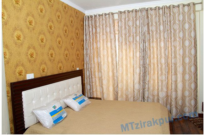 a well designed  bedroom with lots of space..and large size  window to feel fresh air .
