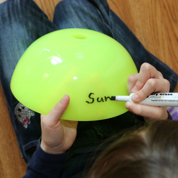 Practice naming the planets in order in this gross motor game