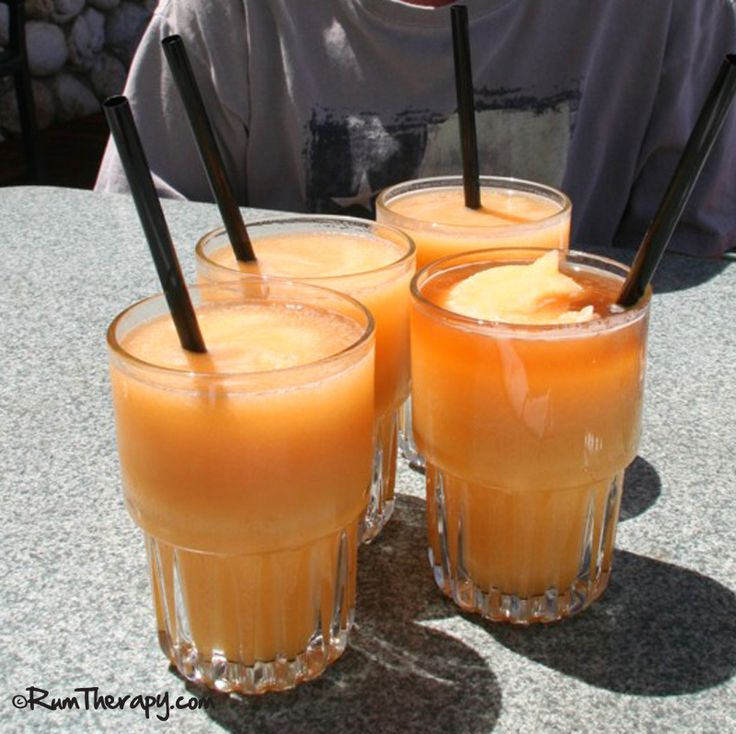 10 Best Tropical Rum Drinks - Why is it that the taste of a tropical rum drink can sometimes transport us right back to a hammock on a beautiful beach or a great time with friends at one of our favorite beach bars? Still, whenever I taste a piña colada, I can close my eyes and almost feel a light sea breeze blowing while lounging on our boat.  We've put together a list of 10 Best Tropical Rum Drinks – those that we remember fondly from our past vacations in the sun.