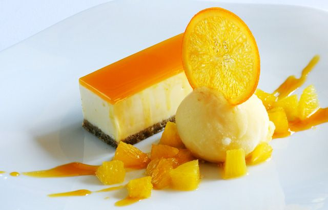 Passion fruit and white chocolate cheesecake with fresh orange sorbet by Matthew Tomkinson