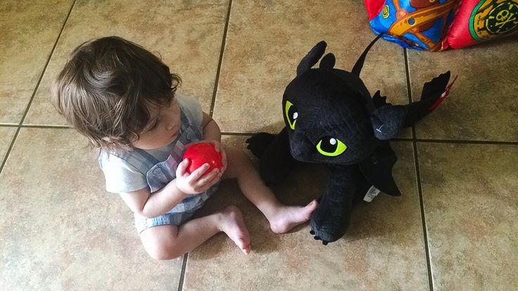 Baby with his first build a bear toothless!