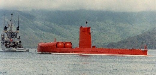 On 13 April 1986, USS GRAYBACK (SS/SSG/LPSS-574), stripped down to an empty shell and painted bright orange, was towed out of Subic Bay in the Philippines and sunk in the South China Sea as a targe…