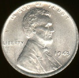 This is an image of the 1943 steel penny (obverse). Due to wartime needs of copper for use in ammunition and other military equipment during World War II, the United States Mint researched various ways to limit dependence and meet conservation goals on copper usage. After trying out several substitutes (ranging from other metals[1] to plastics[2]) to replace the then-standard bronze alloy, the one-cent coin was minted in zinc-coated steel.