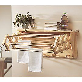 Wall shelf drying rack for the laundry room. This would be awesome for the only things I like hung dried...bathing suits and bras.