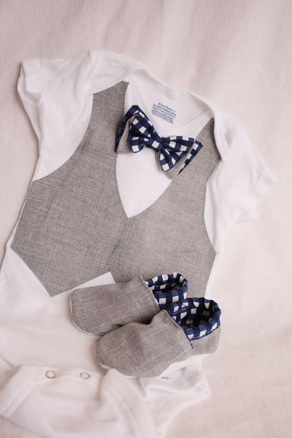 This baby boy body suit is embellished with a gray vest made out of suiting fabric, each edge is hemed for a neat professional look.. the Bow tie is a