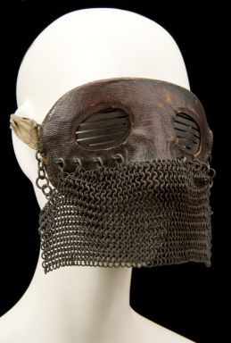 Mask worn by British crews in tanks during WWI to protect against splinters from explosions.