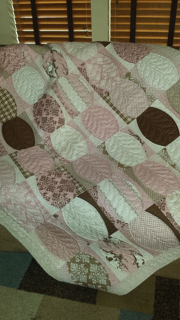 Quilt using the Quick Curve ruler and a layer cake. Custom quilting by Stitchnquilts.     https://www.etsy.com/listing/264461109/pink-pearls-quilt-lap-baby-girl-nursery?ref=shop_home_active_5
