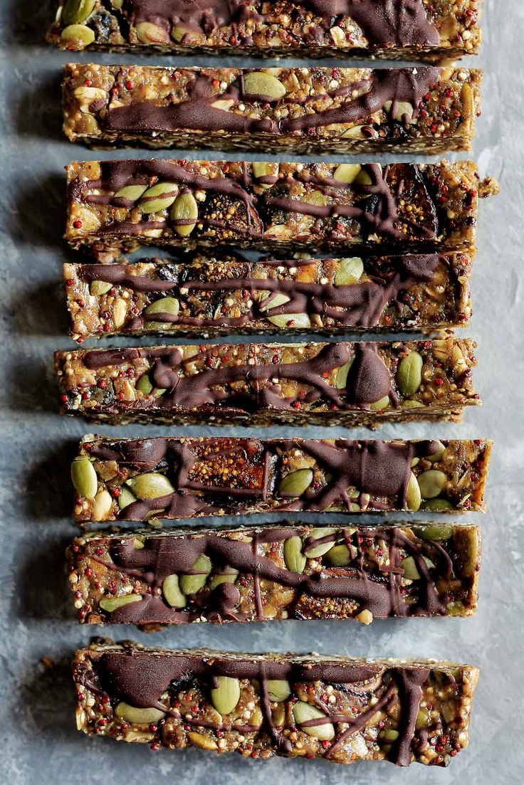 Superfood nut free granola bars made with toasted quinoa, oats, dried figs, sunflower seeds, pumpkin seeds, flaxseed and chia.